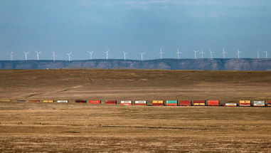 Windfarm with Passing Train